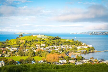 Glowing evening over historical suburb of Devonport, view from Mount Victoria. Auckland, New Zealand.