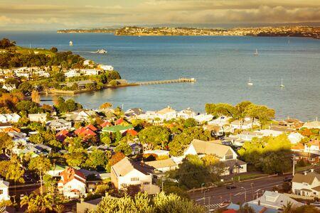 Historical suburb of Devonport basking in warm sunset light. Auckland, New Zealand.
