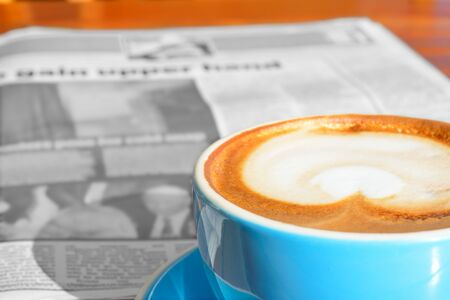 Morning newspaper and coffee latte. Concept of businessman's breakfast. Selective focus Stockfoto - 150173466