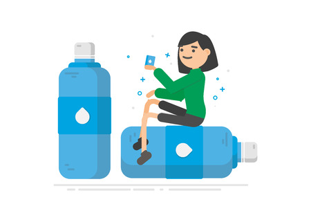 Young woman is drinking water from a plastic bottle.