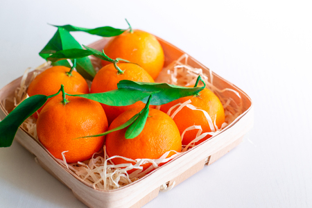 Fresh picked mandarins on  isolated on white background