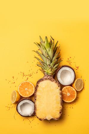 Tropical pineapple, oranges, lemon and coconut on a pastel background. 版權商用圖片