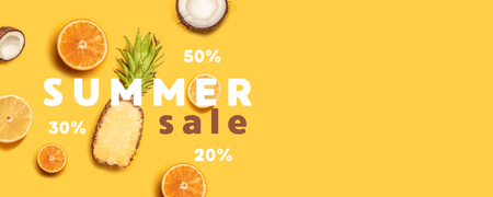 Pineapples, oranges, lemons, coconuts on yellow background. Summer fruits. Flat lay, top view, copy space