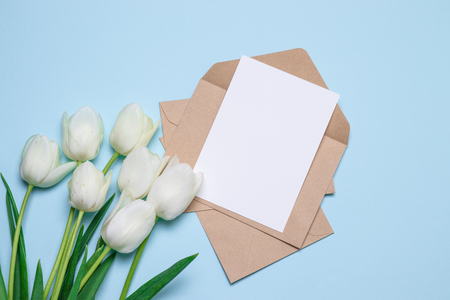 Beautiful tulips bouquet card for text on blue background top view. Mother day