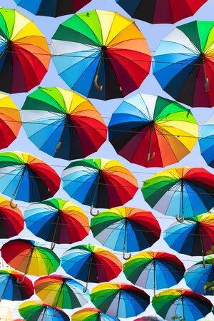 Street decoration. Colorful umbrellas background. The sky of colorful umbrellas