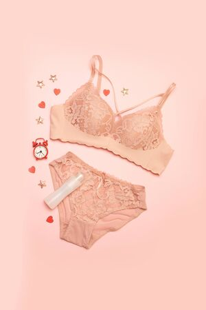 Blogger concept. Set of glamorous stylish sexy lace lingerie with womens accessories on a pink background.