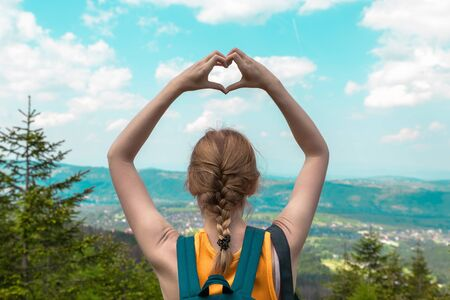 Travel and Vacation concept. Hands heart love symbol shaped women traveling lifestyle charity help concept vacations in mountains landscape