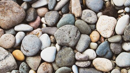 Pebble beach background, stone floor. Abstract nature pebbles background. Sea peblles beach. Beautiful nature.
