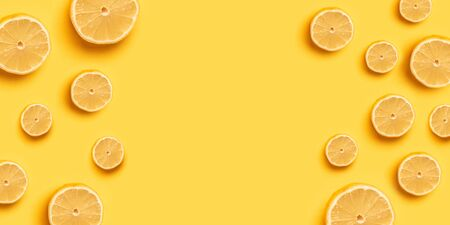 Abstract background with citrus fruits. Orange slices. High Vitamin C, juicy and sweet. Fresh orange orange fruit pattern on a yellow background for a banner or poster. Copy space