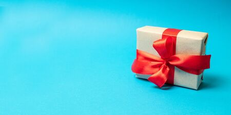 Christmas gift boxes with christmas decoration on blue background. Square shot
