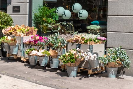 Stockholm, Sweden June 7 2019: Natural beautiful flowers in pastels tones peach, lila, pink, beautiful floral bouquets with the price in a flower shop