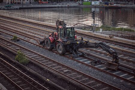 Stockholm, Sweden June 7 2019: Excavators machine excavate on railway Reklamní fotografie