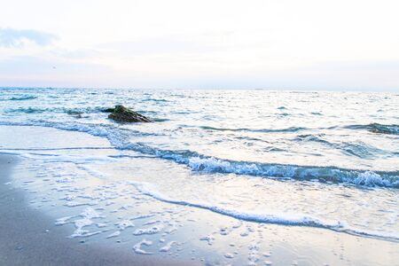 Composition of nature seascape panorama. Black Sea with stones from the water