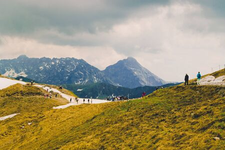 Beautiful panorama of green mountains hills with snow from Kars to Kasprowy Wierch in summer. Travel and tourism concept. Banco de Imagens