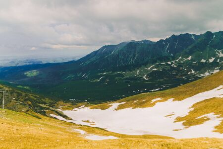 Beautiful panorama of green mountains hills with snow from Kars to Kasprowy Wierch in summer. Travel and tourism concept. Reklamní fotografie