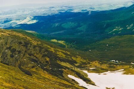 Tourism Day. Beautiful panorama of green mountains hills with snow from Kars to Kasprowy Wierch in summer. Travel and tourism concept.
