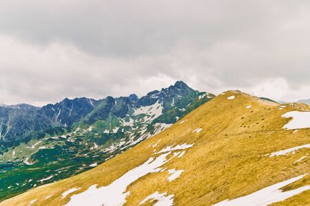 Tourism Day. Beautiful panorama of green mountains hills with snow from Kars to Kasprowy Wierch in summer. Travel and tourism concept. 写真素材 - 128772526