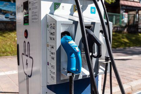 Polish Tatras, Poland July 24, 2019: Environmental concern. Electric car charging station. Power supply for electric car charging. 新聞圖片