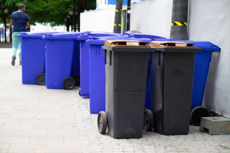 Urban litter bins. Black street bins for separate waste collection. Eco-friendly waste