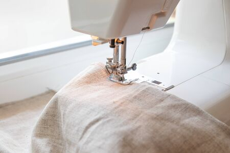 Closeup the sewing machine and item of clothing, sewing machine,