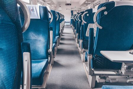 A modern train with comfortable and colorful chairs. Фото со стока