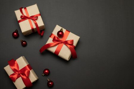Christmas presents on dark background. Minimal concept. Stock Photo - 130911940
