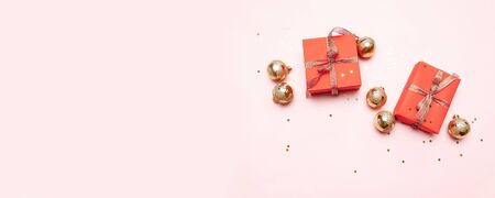 Minimal christmas newyear concept of Christmas red gift boxes, balls on pastel pink background. Creative flat lay, top view design Stock Photo
