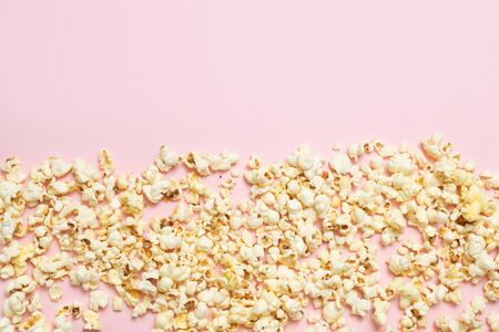 Cinema, movies and entertainment concept. Top view of tasty popcorn pattern on pink background. Stock Photo - 131475164
