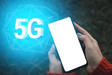 Concept of 5G network.High speed internet network communication, woman using mobile smartphone with 5G