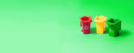 Multicolored sorting garbage bins on a green background. Save the planet concept. Can be used for banner, poster, flyer, informational picture.