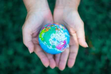 Two hands holding the earth in palm gesture. Ecology concept. Environment Earth Day Banco de Imagens