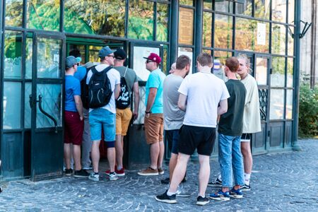 Budapest, Hungary - September 13, 2019: People queuing in front of museum building. Waiting for a ticket purchase 新聞圖片