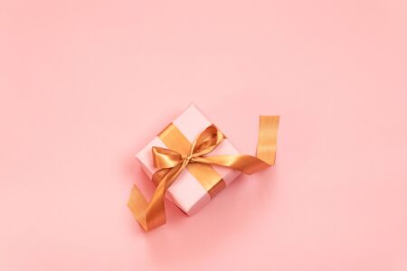 Congratulation card with Gift or present box on pink table top view. Flat lay composition for birthday, mother day, merry christmas and new year Stock Photo