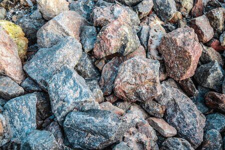 Large sharp gray wet stones background. Industrial activity, treasure