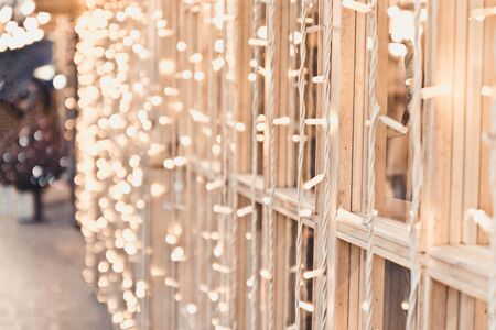 Yellow garland of lights on the window frames of a restaurant or cafe. Christmas or New Year decorations