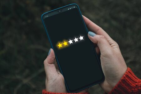 Feedback, review and increase rating concept banner. Digital phone user give five stars in his review and feedback.