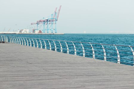 Panorama of a wooden pier in the city of Odessa. Langeron on a summer day on Black Sea. Mediterranean Sea. Embankment by the sea. Travel concept