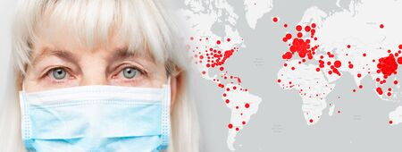 Adult woman 50 60 years old in a medical mask on the background of the epicenter of the epidemic world map. Prohibition of movement, flights between countries due to coronavirus. Fatalities from a strain of virus covid 19