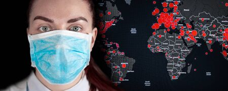 Face of a young girl in a medical mask with a text place for text on a dark background. World map of the world with red areas of the virus outbreak epidemic. Can be used for banner, article, news. Фото со стока