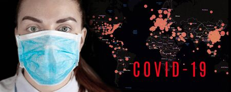 A woman in a medical surgical mask looks at the camera against the background of a world map with red circles indicating epidemic. Virus Pandemic Protection Concept Фото со стока