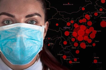 Corona virus world map with a woman in a medical surgical mask looking at the camera on a dark background. Coronavirus epidemic, word COVID-19 on global map.