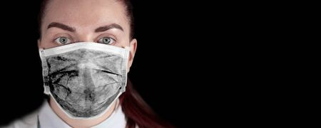 Coronavirus pandemic horizontal web banner with young girl in a black medical mask with a text dfs on a dark background. Can be used for web banner, article, news. Фото со стока
