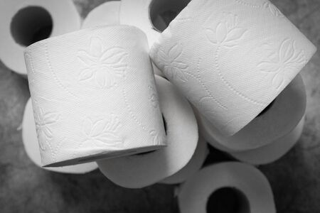 Stocks of many rolls of toilet paper at home. Basic hygiene article shortage Фото со стока