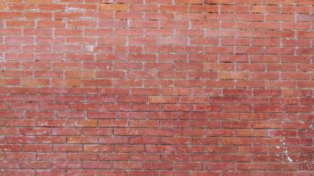 Red brick wall texture grunge background to interior design. Modern loft style Standard-Bild