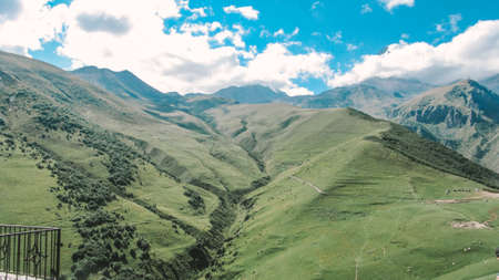 Panorama of beautiful springtime green hills of the mountain and the road