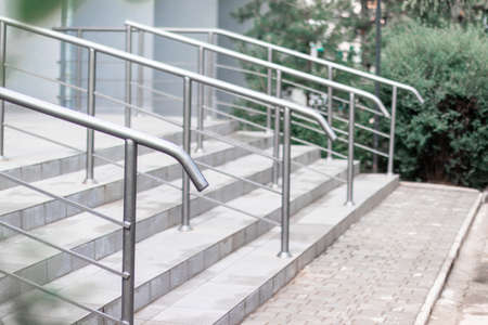 Staircase at the entrance of a multi-storey building. Steps of stairs in the staircase. Modern staircase in urban surrounding