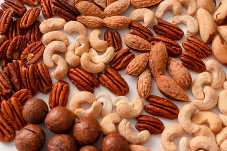 Background of mix nuts pecan, macadamia, walnut, almonds, hazelnuts Top view, flat lay