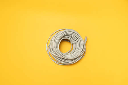 Cat5 nternet odem able on a yellow background