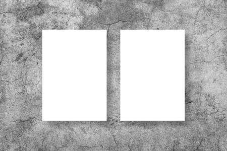 Blank white vertical rectangle poster mock up in white frame on gray background. Standard-Bild