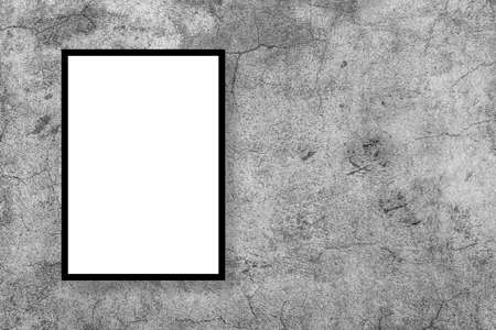 Blank white poster mock up leaning on a grey studio wall